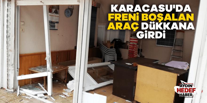 Karacasu'da freni boşalan araç dükkana girdi
