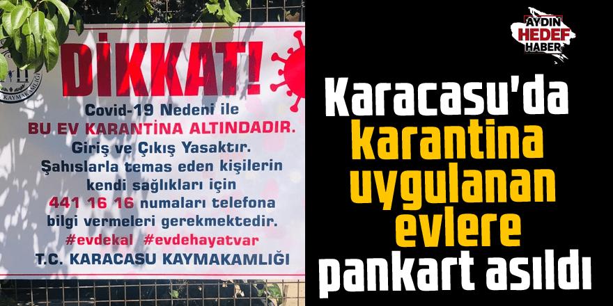 Karacasu'da karantina uygulanan evlere pankart asıldı