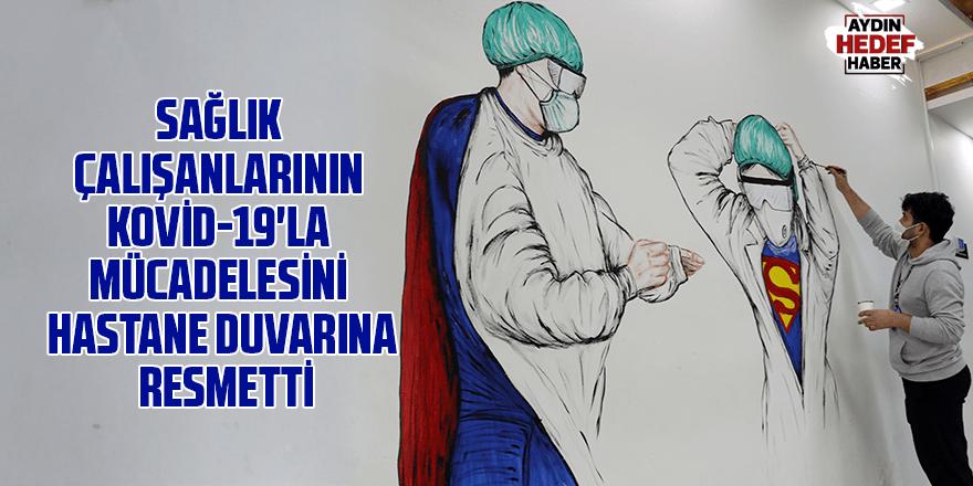 Sağlık çalışanlarının Kovid-19'la mücadelesini hastane duvarına resmetti