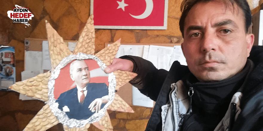 Çöpe atılan Atatürk fotoğrafına işçiler sahip çıktı